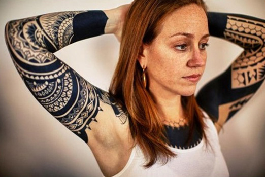 tatouage tribal femme bras