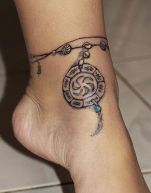 tatouage tribal femme cheville